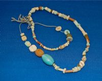 An interesting string of around 100 varied Ancient Egyptian multi-coloured beads & amulets. SOLD